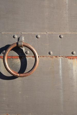 doorhandle: Closeup of old rusty metal door with big ring door-handle