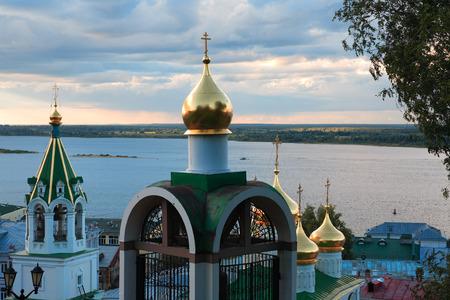 nizhni novgorod: Nice Russian church with golden cupola. View across Volga river in Nizhni Novgorod, Russia