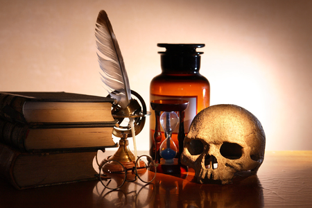medieval medicine: Ancient science concept. Vintage still life with human skull near books and old things