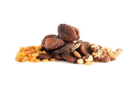 grape fruit: Heap of dried fruits and nuts on white background