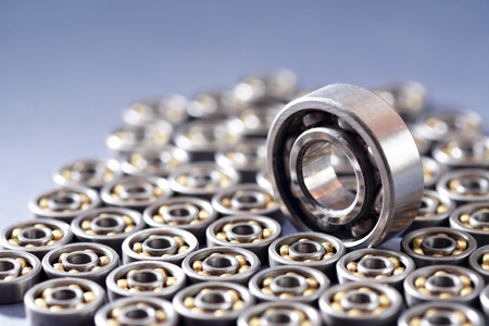 ball bearing: One big ball bearing among lot of small ball bearings