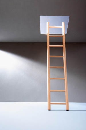 ceiling light: Wooden ladder in empty room with illuminated hatch in ceiling