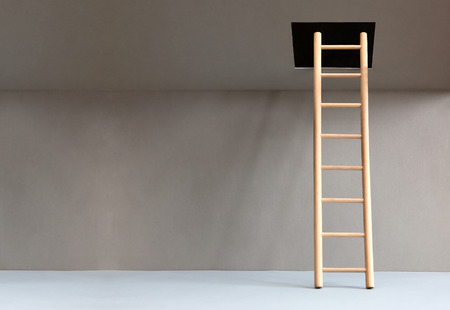 suspense: Wooden ladder in abstract empty room with hatch in ceiling