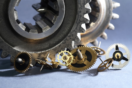 joblessness: Set of various gears on gray background