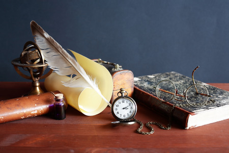old letters: Quill pen near scroll and other vintage things