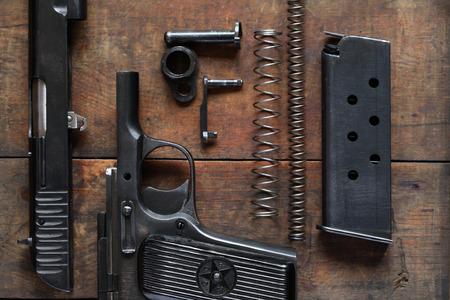 dismantled: Soviet dismantled handgun on old wooden background Stock Photo