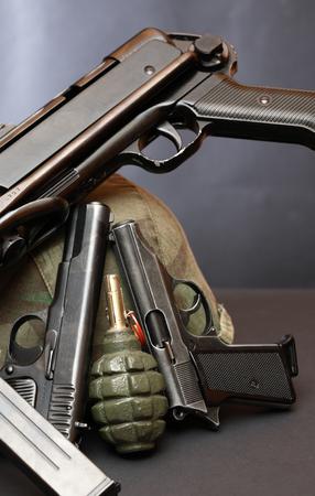 machine-gun: Set of various firearm weapons and grenade on dark background