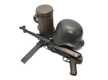 machine-gun: World War II Germany soldier equipment. Machinegun MP-38 near helmet and respirator case Stockfoto