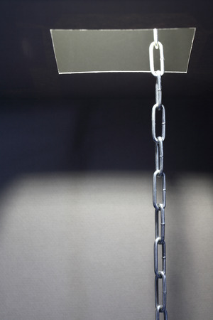 suspense: Escape concept. Metal chain inside hatch in ceiling Stock Photo