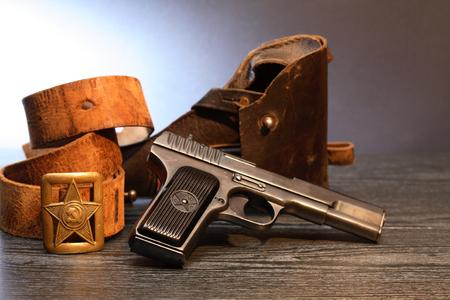holster: World War II Soviet officer equipment. Officer leather belt near handgun and holster