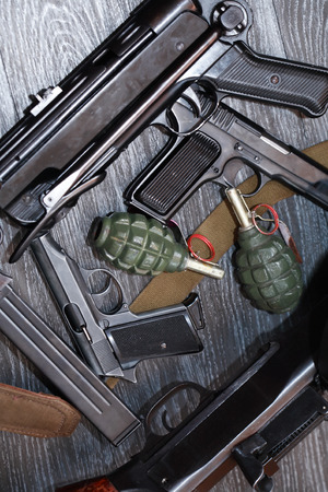 machinegun: Terrorism equipment. Set of various firearm weapons and grenades on dark background