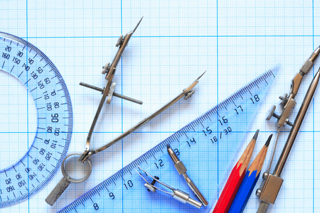 design tools: Set of drawing instrument and rulers on graph paper