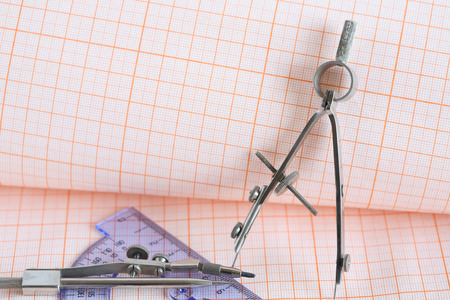 drawing instrument: Set of drawing instrument and ruler on graph paper background