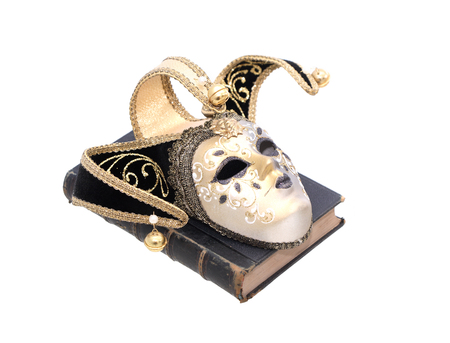 theatre masks: Art concept. Vintage still life with old book and Venetian mask