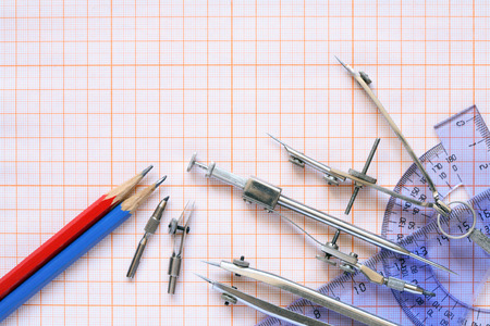 drawing instrument: Set of drawing instrument and rulers on graph paper