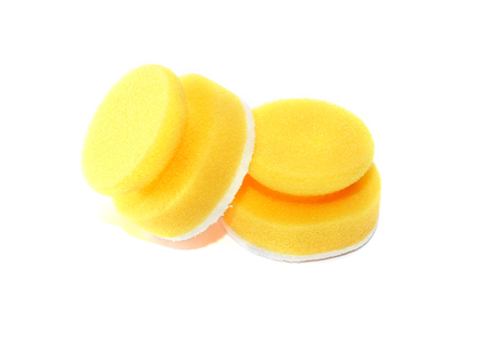 disinfect: Pair of new yellow kitchen sponges on white background Stock Photo
