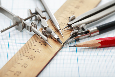 drawing instrument: Set of vintage drawing instrument and ruler on graph paper Stock Photo