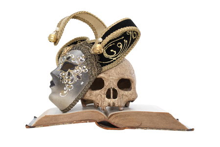 calaveras: Art concept. Vintage still life with Venetian mask near skull on old book
