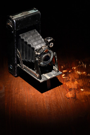 film shooting: Closeup of old film camera on nice wooden background