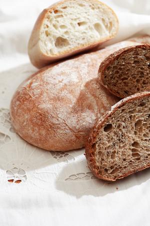 cosiness: Farm still life. Freshness bread set on white tablecloth