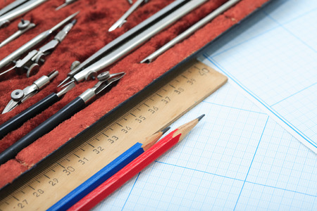 drawing instrument: Set of drawing instrument in box and ruler on graph paper