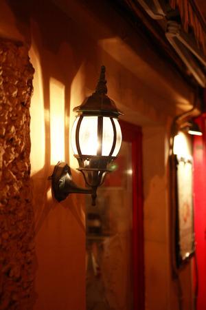luminous: Nice luminous street lamp on building wall at night