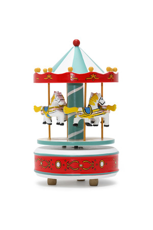 wood turning: Vintage wooden toy carousel horses on white background. Clipping path is included