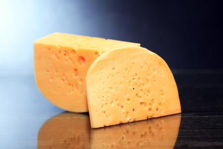 reverberation: Piece of cheese on nice dark background with reverberation