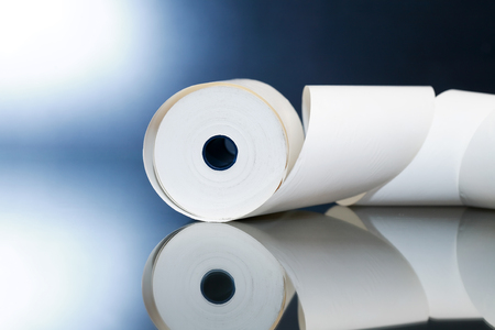 reverberation: White paper roll with reverberation on dark background