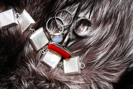 silver jewelry: Set of silver jewelry on fox fur background