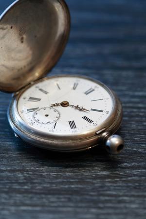 inoperative: Hour workshop. Ancient inoperative silver pocket watch Stock Photo