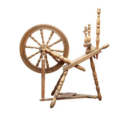 Nice ancient wooden spinning wheel on white background. Isolated with clipping path