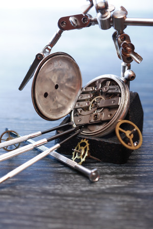 workmanship: Vintage still life with ancient silver pocket watch