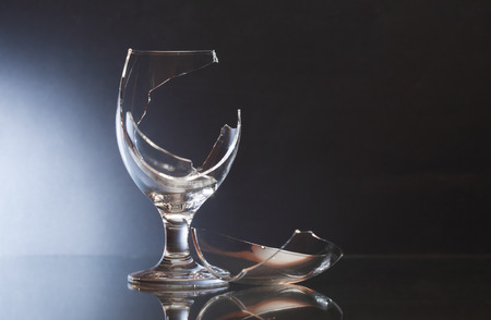 splinter: One broken wineglass on nice dark background