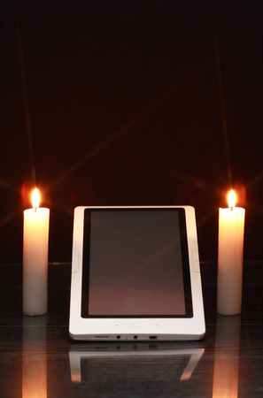 bible altar: Lighting candles around tablet like a sanctuary