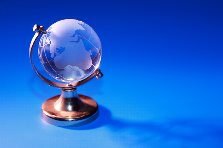 glass globe: Glass globe on blue background with free space