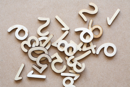 numbering: Bookkeeping symbol. Set of wooden digits on brown paper background