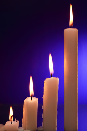 blackout: Set of lighting candles on nice dark background Stock Photo