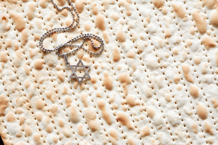 seyder: Seder concept. Star of David symbol lying on matzah background Stock Photo