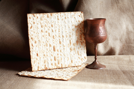 matzoh: Seder concept. Still life with matzoh near metal wineglass Stock Photo