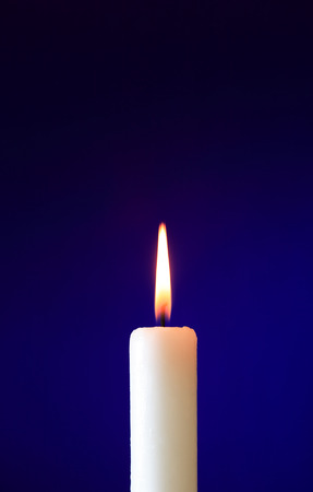 lighting background: One lighting candle on nice dark background with free space