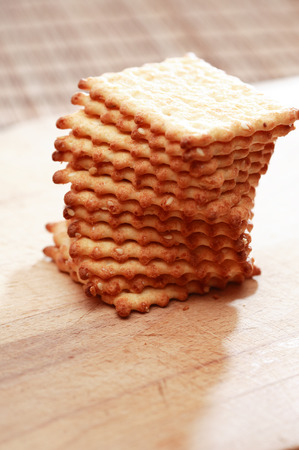 against the sun: Stack of crackers on wooden board against sun light