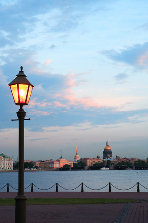 View of Saint Petersburg in Russia across Neva river at sunset with street lamp