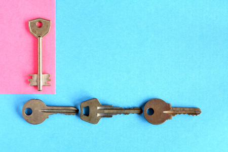 think safety: Abstract composition with door keys on color paper background