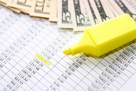 felt tip: Yellow felt tip pen near money on paper background with digits
