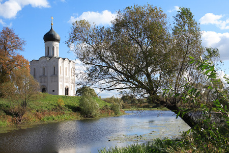 Old Russian church on Nerl river against blue sky