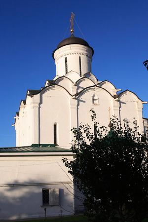 View of nice ancient Russian monastery against blue sky, city of Vladimir