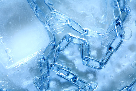 Abstract background. Metal chain under frozen water with ice