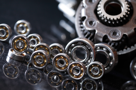 Machinery concept. Set of various gears and ball bearings on dark background Фото со стока - 71656752