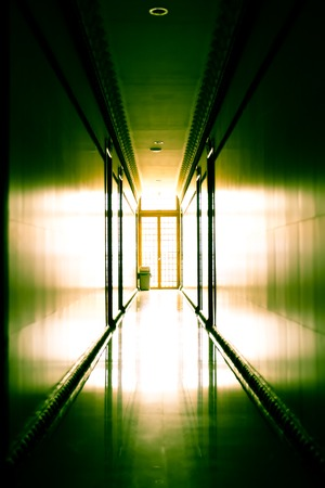 Interior of nice empty modern hotel with corridor against light Stock Photo